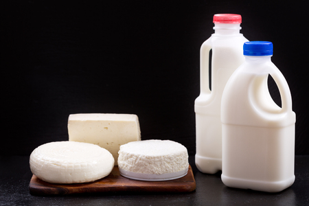white cheese: various dairy products over black background Stock Photo