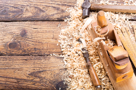 old tools: wooden planer, hammer, chisel  in a carpentry workshop, top view Stock Photo