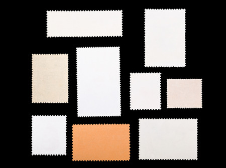 set of blank postage stamps on a black background Foto de archivo