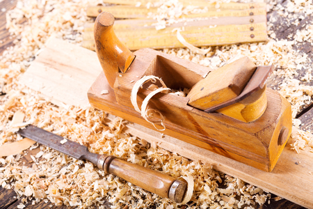 old wooden planer with sawdust in a carpentry workshop Stock Photo