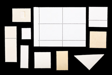 postage stamps: set of blank postage stamps on a black background Stock Photo