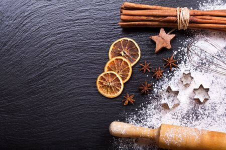 christmas cooking: Christmas cooking:  baking ingredients, anise stars and cinnamon sticks on dark background