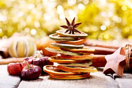 holiday food: christmas tree made of dried fruits and anise star on wooden table