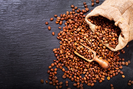 coffee sack: Coffee Beans in a Sack on dark background, top view Stock Photo