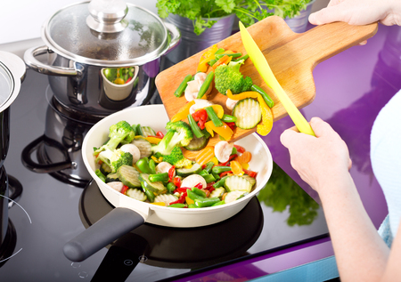 stir fried: Cooking. Woman prepare fried vegetables in the kitchen