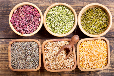 seeds of various: various cereals, seeds, beans and grains on wooden table Stock Photo