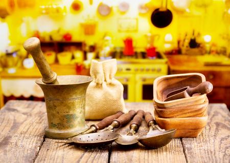 kitchen utensils: Various kitchen utensils on wooden table