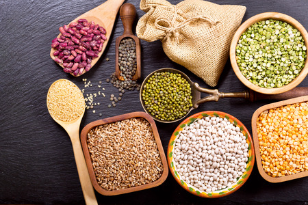 seeds of various: various cereals, seeds, beans and grains on dark background Stock Photo