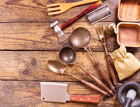 kitchen table top: Various kitchen utensils on wooden table, top view Stock Photo