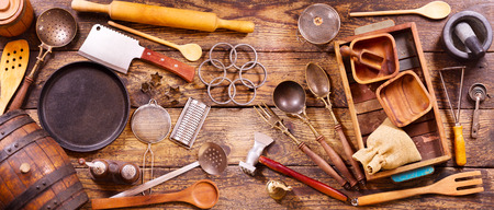 table set: Various kitchen utensils on wooden table, top view, banner