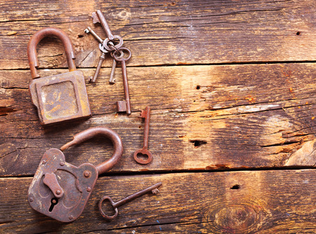 rusty: old rusty locks and keys on wooden table, top view Stock Photo