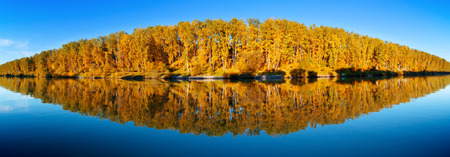 water fall: autumn landscape of forest lake with reflections, panorama