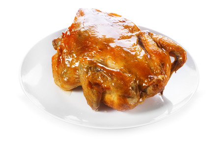 carne de pollo: plate of roasted chicken isolated on white background