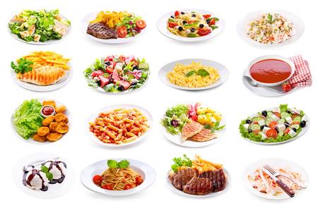 흰색 배경에 고립 된 음식의 다양 한 접시의 집합