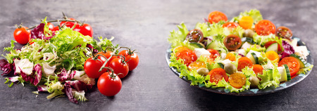 plato de ensalada: plate of fresh salad with vegetables and ingredients for cooking salad on dark background