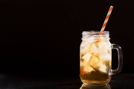 iced tea in a jar on a dark background