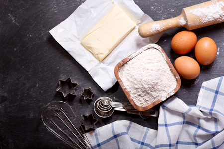 pin board: ingredients for baking : flour, eggs, butter and kitchen utensils for cooking