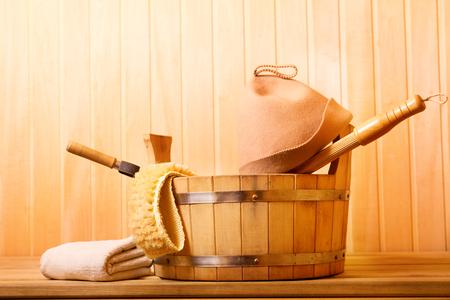 finnish bath: various sauna accessories in a wooden sauna