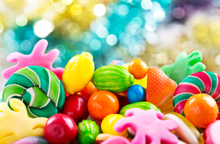 Various colorful candies, jellies, lollipops and marmalade as background
