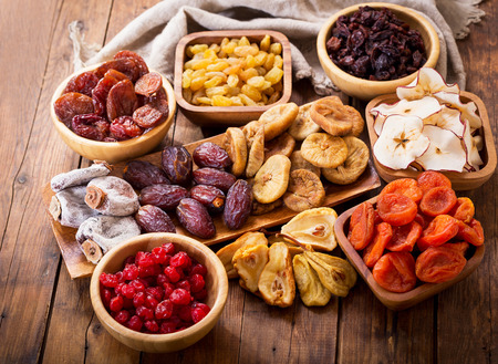 various dried fruits on wooden table, top view 스톡 콘텐츠