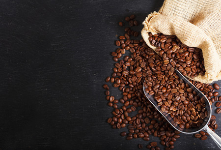 coffee beans in a sack on dark table, top view Stockfoto