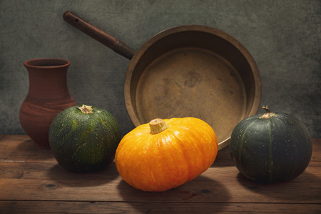 still life with pumpkin and fresh vegetables on a wooden table Stockfoto