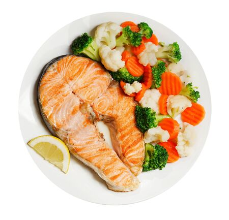 plate of grilled salmon steak with vegetables isolated on white background, top view Reklamní fotografie - 127584355