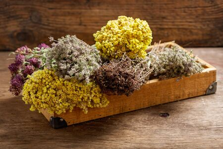 Various dried herbs on wooden table Reklamní fotografie - 128655788