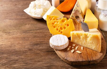 various types of cheese on a wooden board Reklamní fotografie - 128679113
