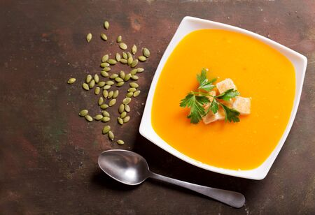 bowl of pumpkin soup with parsley,  top view Stockfoto