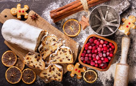 Christmas cake with ingredients for cooking. Christmas baking background, top view Stockfoto