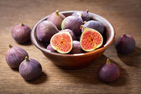 bowl of fresh figs fruit on wooden table