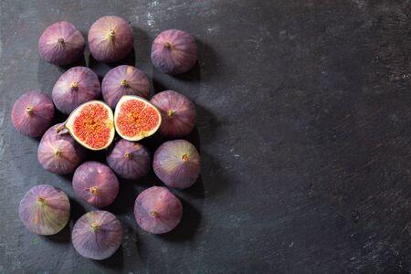fresh figs fruit on dark bakcground, top view