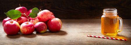 glass jar of apple juice with fresh fruits on wooden table Reklamní fotografie