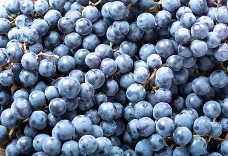 close up of ripe grapes as background, top view