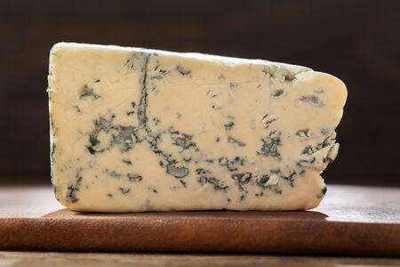 slice of blue cheese on wooden board Reklamní fotografie