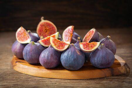fresh figs fruit on a wooden board