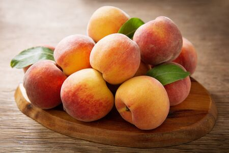 fresh ripe peaches on a wooden table