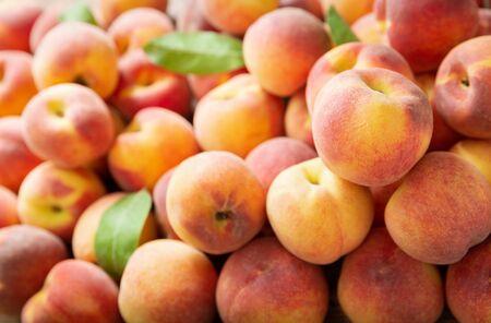 fresh ripe peaches as background