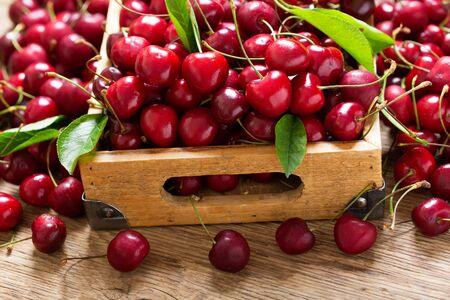 fresh ripe cherries in a wooden box
