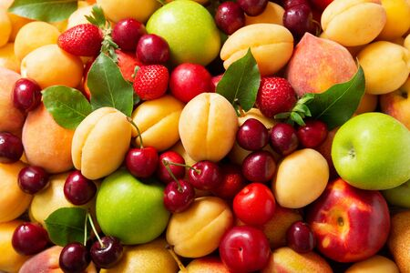 fresh ripe fruits and berries as background, top view Stockfoto