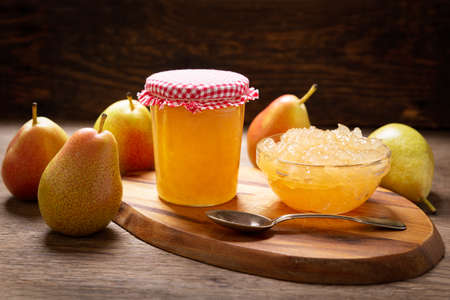 bowl of pear jam and fresh fruits on a wooden table