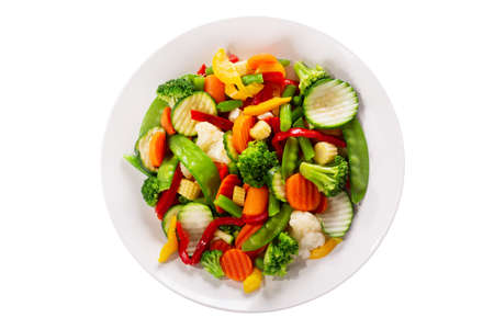 plate of stir fry vegetables isolated on a white background, top view