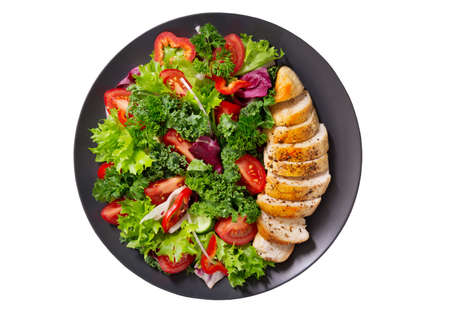 plate of chicken salad with vegetables isolated on white background, top view 版權商用圖片