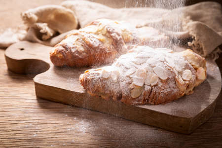 sugar powder pouring over fresh croissants