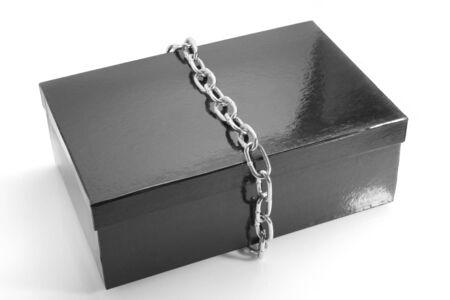 Black cardboard box with a metal chain Stock Photo