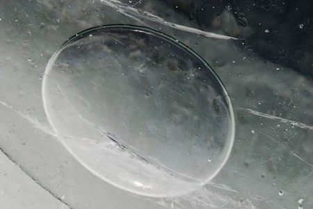 Frozen unusual universe of ovals and cracks