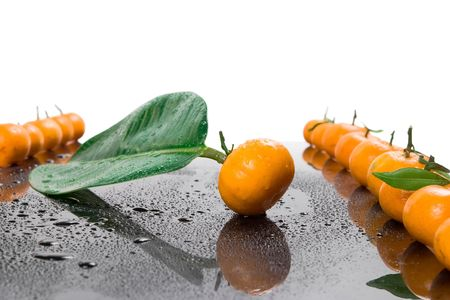 Tangerines lie in a row on the black Stock Photo - 4627334