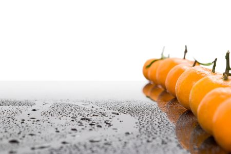 Tangerines lie in a row on the black Stock Photo - 4627335