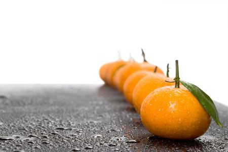 Tangerines lie in a row on the black Stock Photo - 4627331